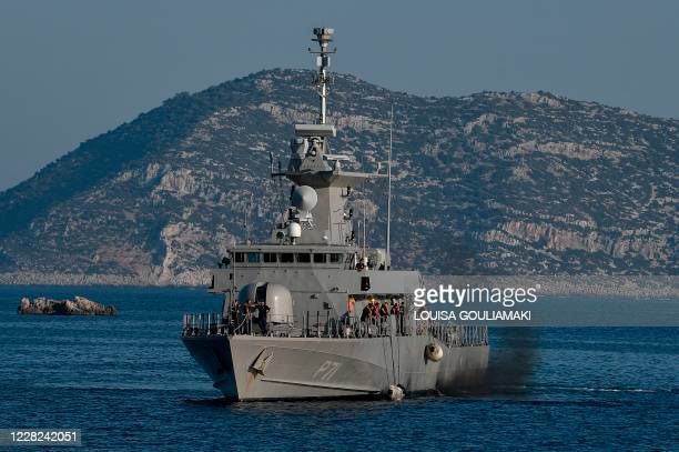 The Hellenic Navy Roussen or Super Vita class Fast Missile Patrol Boat P 71 HS Ritsos patrols off the tiny Greek island of Kastellorizo , in the...