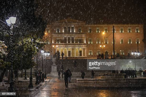 The Hellenic Parliament at Syntagma Square during a snowfall in Athens Greece on January 9 2017 Greece experiences rare cold wave with low...
