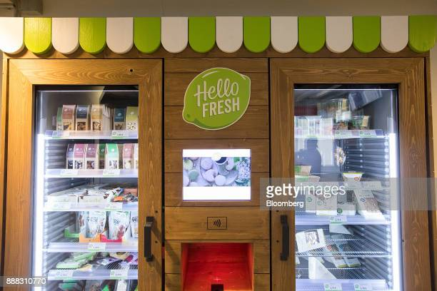 The Hello Fresh SE logo sits on a food vending machine in the reception area of the Delivery Hero AG headquarter offices in Berlin Germany on Friday...
