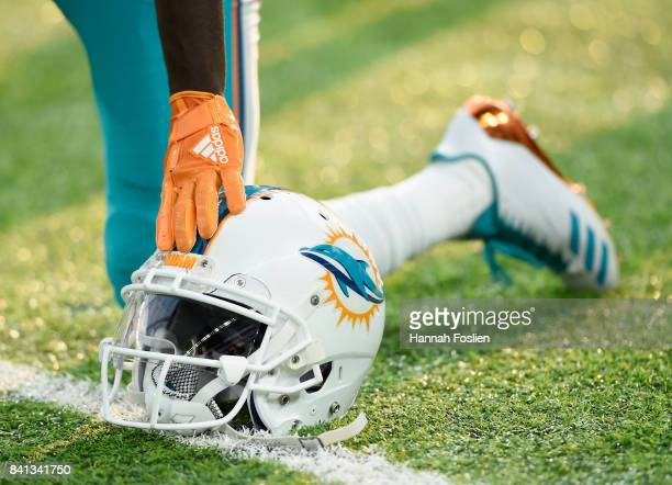 The helmet of Jakeem Grant of the Miami Dolphins is seen as he takes a knee during warmups before the preseason game against the Minnesota Vikings on...