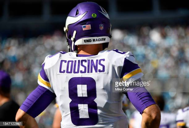 """The helmet of Kirk Cousins of the Minnesota Vikings reads """"End Racism"""" during the game against the Carolina Panthers at Bank of America Stadium on..."""