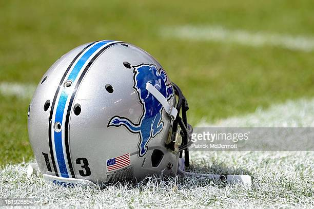 The helmet of Nate Burleson of the Detroit Lions sits on the field before a game against the Washington Redskins at FedExField on September 22 2013...