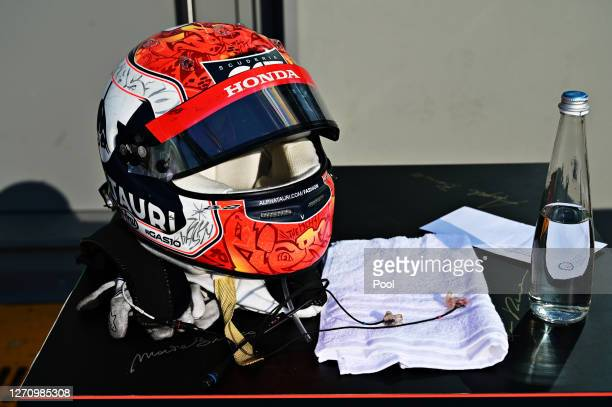 The helmet of Pierre Gasly of France and Scuderia AlphaTauri is seen on a table in parc ferme following the F1 Grand Prix of Italy at Autodromo di...