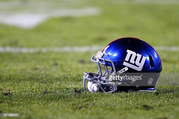 The helmet of running back Ahmad Bradshaw of the New York Giants sits on the grass before the start of the Giants and Washington Redskins game at...