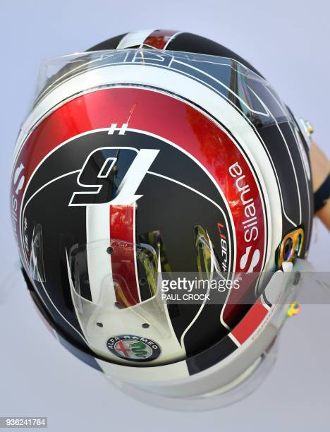 The helmet of Sauber's Monaco driver Charles Leclerc is displayd ahead of the Formula One Australian Grand Prix in Melbourne on March 22 2018 / IMAGE...