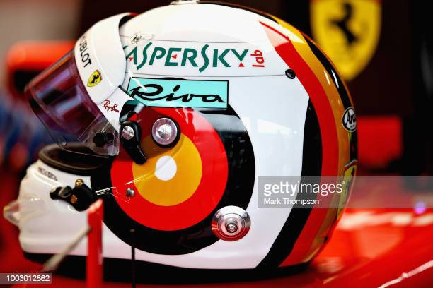 The helmet of Sebastian Vettel of Germany and Ferrari sits on his car in the garage during final practice for the Formula One Grand Prix of Germany...