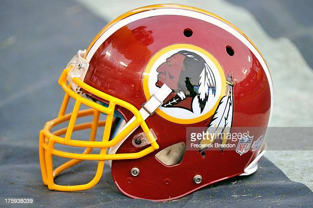 The helmet of the Washington Redskins sits on the sideline during a preseason game against the Tennessee Titans at LP Field on August 8 2013 in...