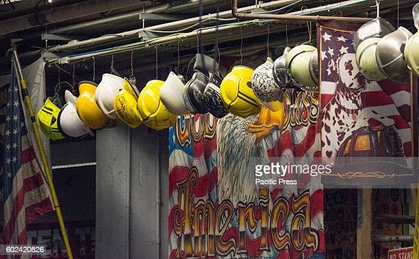 The helmets of fallen firefighters from Engine 10/Ladder 10 near the World Trade Center hang from the ceiling rafters as an ongoing tribute to the...