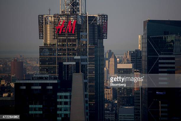 The Hennes Mauritz AB logo is displayed on the 4 Times Square building in New York US on Monday May 4 2015 HM Europe's No 2 clothing retailer...
