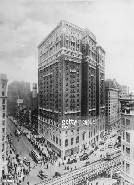 The Herald Square area of Manhattan including the McAlpin Hotel located at the corner of Broadway and 34th Street bustles with activity in this print...