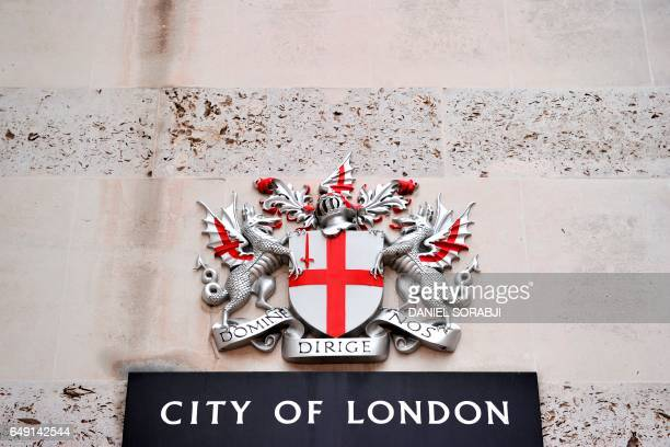 The heraldic achievement of the City of London is seen at the Guildhall in London on March 3 2017 Britain's Finance minister Philip Hammond earlier...