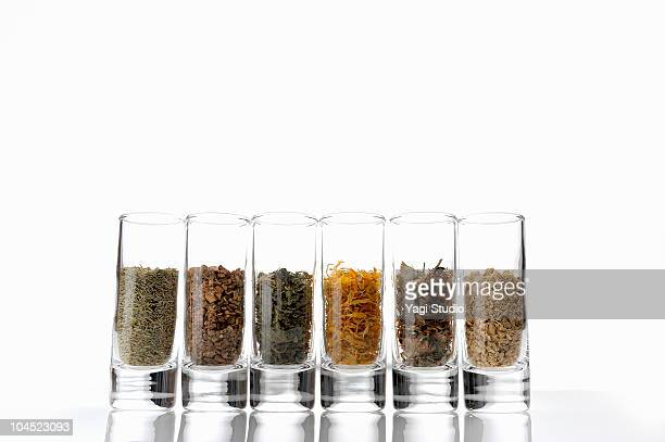 the herbs which a glass container contains  - ginger nettles stock pictures, royalty-free photos & images
