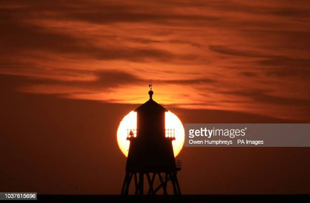 The Herd Groyne lighthouse at South Shields on the North East coast during sunrise. Heavy rainfall and powerful gusts brought by Storm Bronagh are...