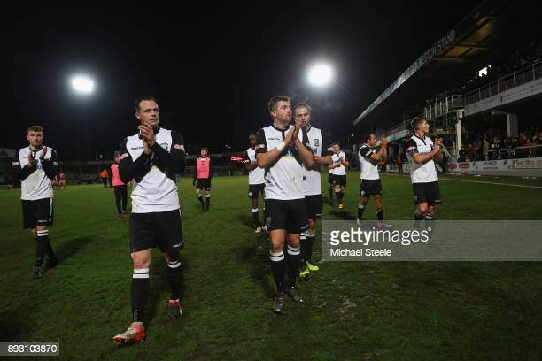 The Hereford players applaud the home supporters after their 02 defeat during the Emirates FA Cup second round replay match between Hereford FC and...