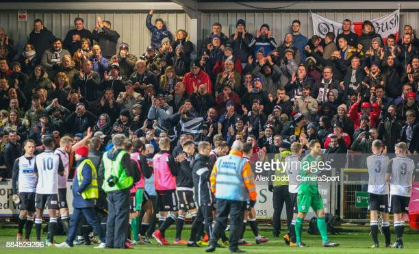 The Hereford team celebrate with their fans after the match during the Sky Bet League One match between Fleetwood Town and Peterborough United at...