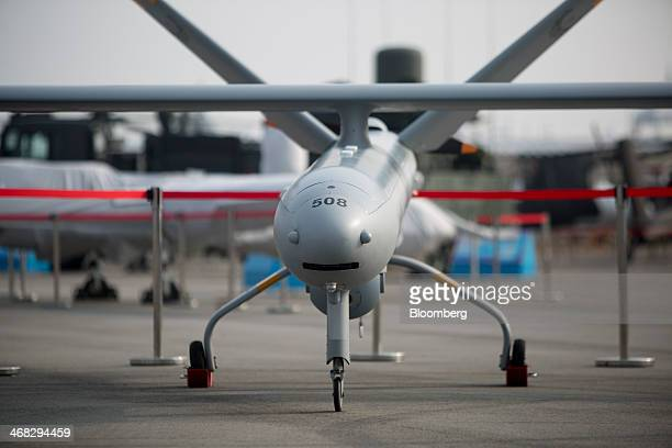 The Hermes 450 unmanned aerial vehicle manufactured by Elbit Systems Ltd stands on display at the Singapore Airshow held at the Changi Exhibition...