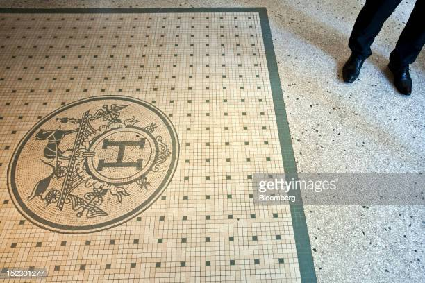 The Hermes logo is displayed on the floor entrance area within a store the company is operated by Hermes International SCA in Paris France on Monday...