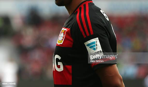 The Hermes logo is seen on the jersey of Karim Bellarabi of Leverkusen during the Bundesliga match between Bayer Leverkusen and SV Darmstadt 98 at...