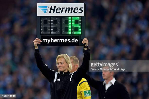 The 'Hermes' substitution board is seen during the Bundesliga match between FC Schalke 04 and FC Bayern Muenchen at VeltinsArena on August 30 2014 in...