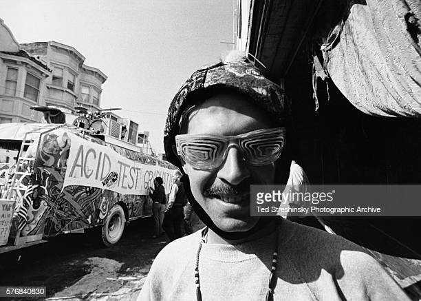 The Hermit a member of Ken Kesey's counterculture group the Merry Pranksters wears sunglasses painted with dayglo colors The Merry Pranksters' bus is...