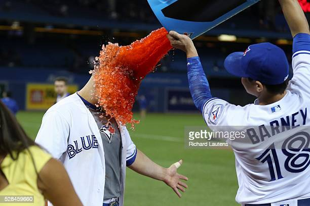 TORONTO ON MAY 4 The hero of the game Toronto Blue Jays catcher Russell Martin gets the gatorade treatment from Toronto Blue Jays second baseman...