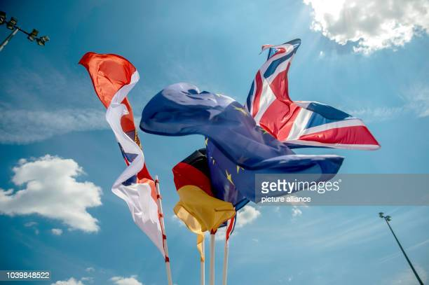 The Hessian German EU and British flag have been hoisted for the visit of Britain's Queen Elizabeth II at the airport in Frankfurt/MainGermany 25...
