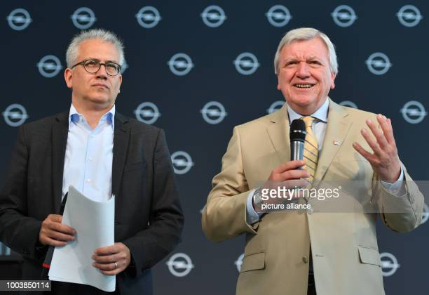 The Hessian Premier Volker Bouffier and his deputy the Hessian Minister of economy Tarek AlWazir speak during a press conference at the AdamOpelHaus...