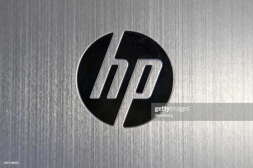 The Hewlett-Packard Co. logo is displayed on the back of the Envy x2 displayed for a photograph in San Francisco, California, U.S., on Wednesday, March 13, 2013. The one-two punch of Apple's iPad and Microsoft's Windows 8 has led to a new class of personal-computer of hybrids that look and work like regular laptops, but whose screens pop off to become fully functional tablets. Photographer: David Paul Morris/Bloomberg via Getty Images