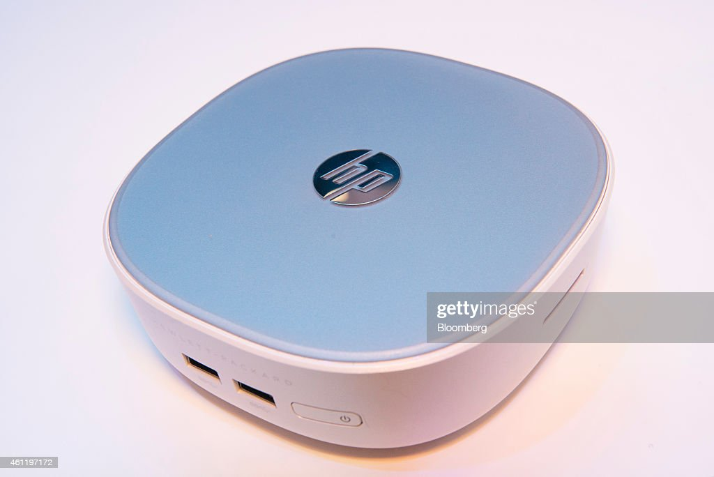 The Hewlett-Packard Co. (HP) Pavillion Mini Desktop computer is displayed at the 2015 Consumer Electronics Show (CES) in Las Vegas, Nevada, U.S., on Thursday, Jan. 8, 2015. This year's CES will be packed with a wide array of gadgets such as drones, connected cars, a range of smart home technology designed to make everyday life more convenient and quantum dot televisions, which promise better color and lower electricity use in giant screens. Photographer: David Paul Morris/Bloomberg via Getty Images