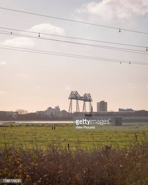 The hide in its context with the Middlesbrough Transporter Bridge ini the background. Saltholme Pools Hide, Middlesbrough, United Kingdom. Architect:...