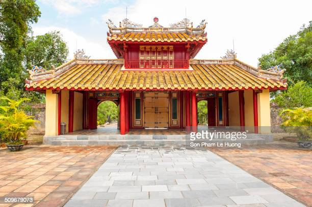 The Hien Duc Gate at the Min Mang Mausoleum a UNESCO World Heritage Site. Built to a traditional style with red and yellow being the predominant...