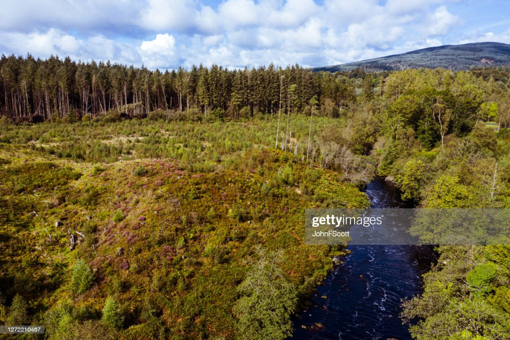 The high angle aerial view of a river flowing through rural Dumfries and Galloway : Stock Photo