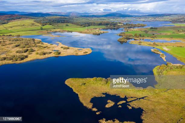 the high angle aerial view of a slow moving river in rural dumfries and galloway south west scotland - johnfscott stock pictures, royalty-free photos & images