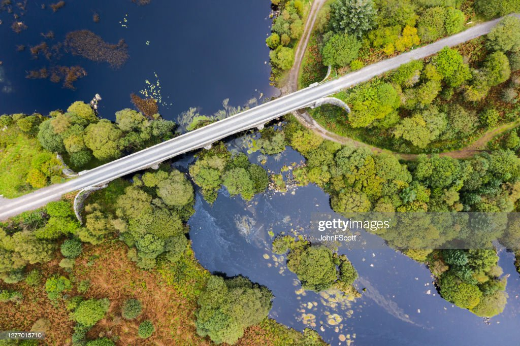 The high angle view looking down on a disused railway viaduct in rural Scotland : Stock Photo