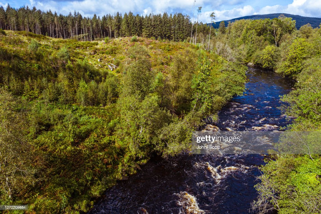 The high angle view of a river flowing through remote rural Dumfries and Galloway : Stock Photo