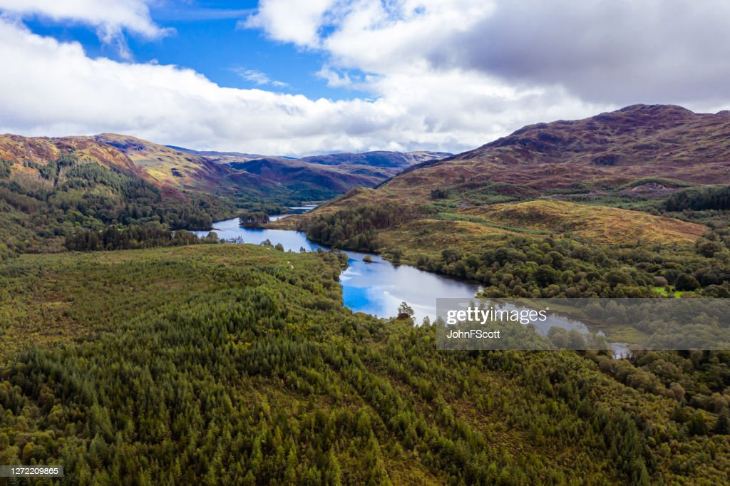 The high angle view of a Scottish loch and forest in Dumfries and Galloway on an overcast day : Stock Photo