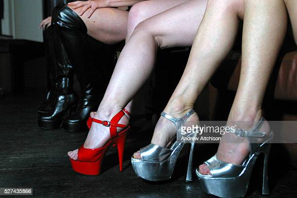 The high heel shoes of girls at a pole dancing class in a central London club
