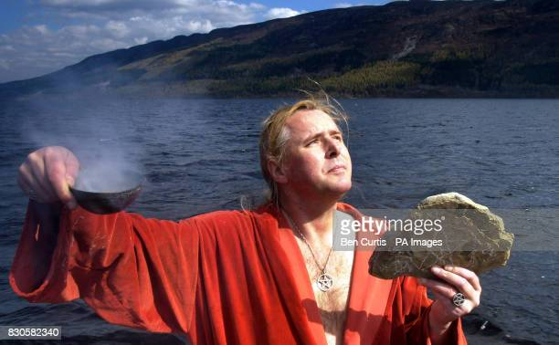 The High Priest of British White Witches Kevin Carlyon, from Hastings, East Sussex, casts a spell from a boat on the waters of Loch Ness to protect...