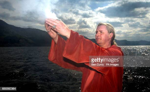 The High Priest of British White Witches Kevin Carlyon, from Hastings, East Sussex,casts a spell from a boat on the waters of Loch Ness to protect...