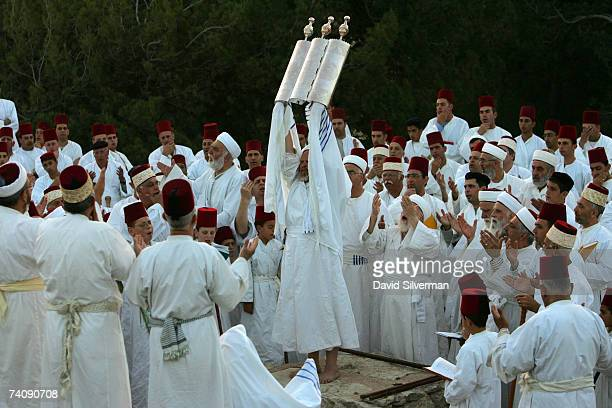 The High Priest of the ancient Samaritan sect holds aloft a silverencased Torah scroll as the community holds prayers at dawn on the last day of...