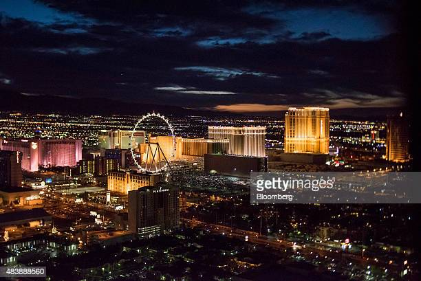The High Roller ferris wheel center and hotels stand on The Strip in this aerial photograph taken at dusk above Las Vegas Nevada US on Wednesday Aug...