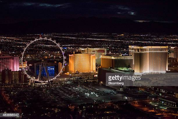The High Roller ferris wheel from left Caesars Entertainment Corp Harrah's hotel Mirage Hotel Resort Casino and the The Venetian stand on The Strip...