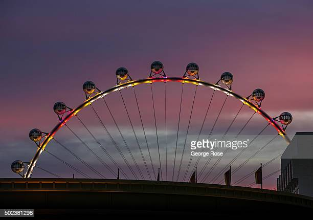 The High Roller the world's tallest Ferris wheel is viewed at sunrise on December 8 2015 in Las Vegas Nevada Tourism in America's Sin City has within...
