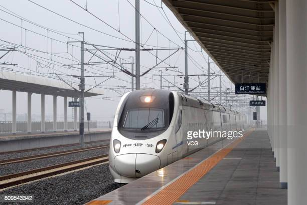 The high speed train D6655 from Beijing South Railway Station arrives at Baiyangdian Railway Station in Xiongan New Area on July 6 2017 in Baoding...