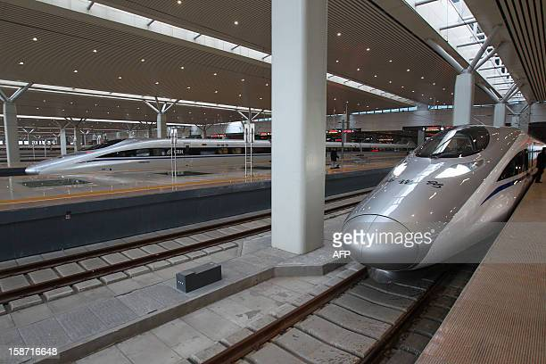 The high speed train that runs on the new 2,298-kilometre line between Beijing and Guangzhou stops at a train station in Zhengzhou, central China's...