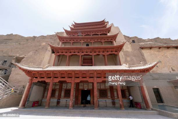The highest building in Mogao cave, with 9 floor height, is the cave for the tallest Buddha statue. The Mogao Caves, also known as the Thousand...