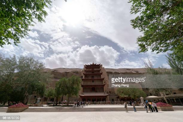 The highest building in Mogao cave with 9 floor height is the cave for the tallest Buddha statue The Mogao Caves also known as the Thousand Buddha...
