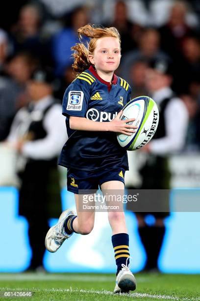 The Highlander ball girl makes her way out on to the field during the round six Super Rugby match between the Highlanders and the Rebels at Forsyth...