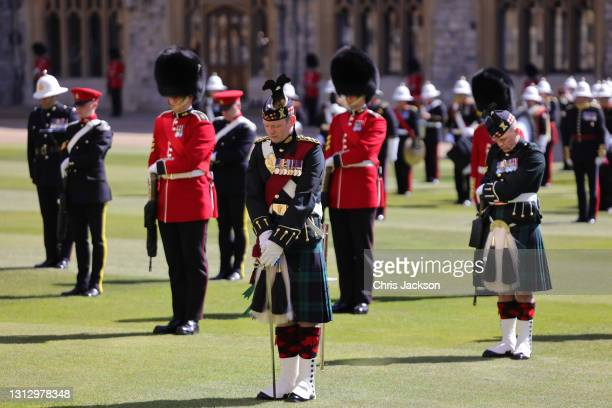 The Highlanders, 4th Battalion, The Royal Regiment of Scotland and Grenadier Guards bow their heads in respect during the funeral of Prince Philip,...