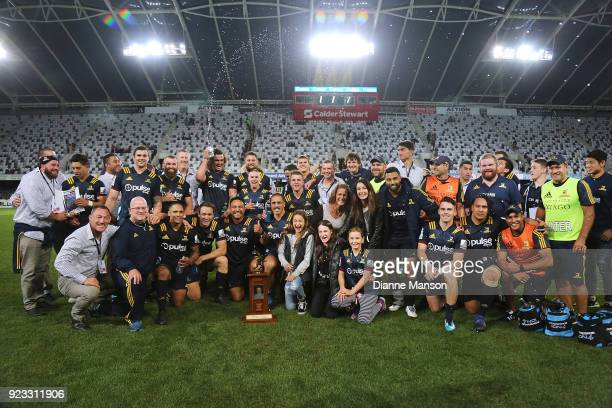 The Highlanders and management pose for a photo with the Gordon Hunter Memorial Trophy after defeating the Blues in the round two Super Rugby match...